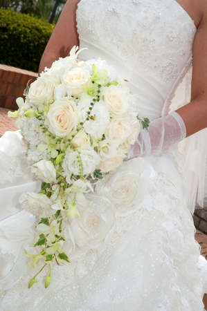 Luxurious white roses are arranged in a nice bouquet of flowers, bridal bouquet