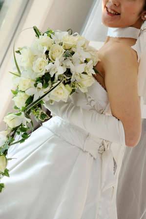nestled: Cute bouquet that was nestled in the gorgeous bride, Wedding Bouquet Stock Photo