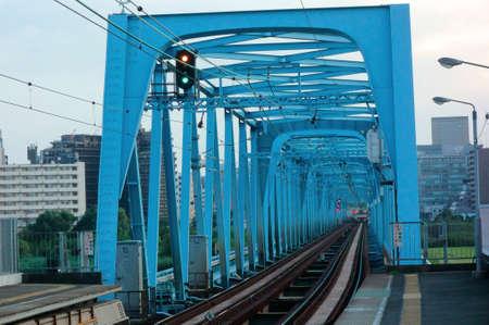 according: Iron bridge, Blue iron bridge according to the riverbed