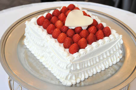 vows: Bridal Image, Very gorgeous strawberry packed wedding cake Stock Photo