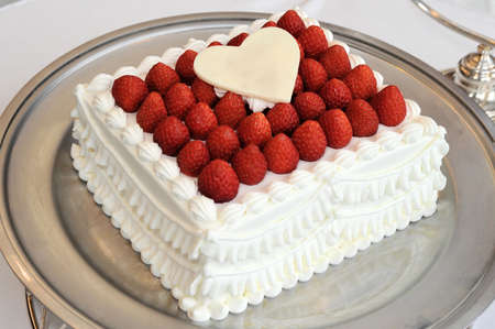 hymn: Bridal Image, Very gorgeous strawberry packed wedding cake Stock Photo