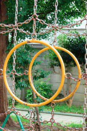 playground equipment: Hanging wheel of playground, Playground equipment in the childrens park