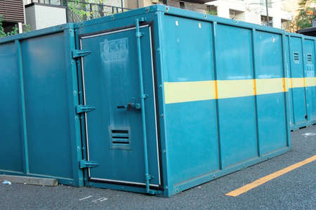 storeroom: Large trunk locker that has been installed in the city of parking