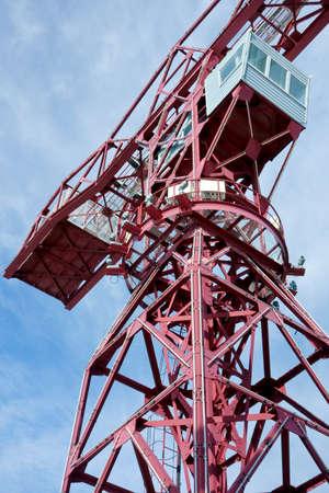 Huge unloading crane at the harbor Stock Photo