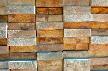 Wood boards stacked highly tightly