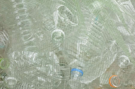 PET bottle for recycling at the disposal site where mesh is put on Banco de Imagens