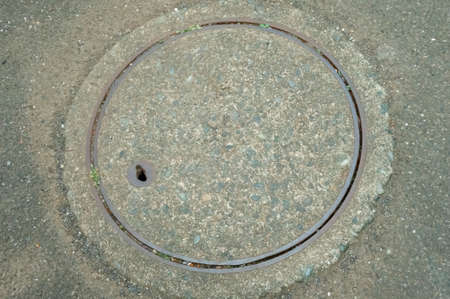 Manhole lid on street street