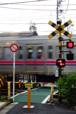 Railroad crossing with red light and warning sound