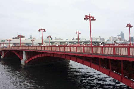 Glossy red bridge in Tokyo Asakusa Редакционное