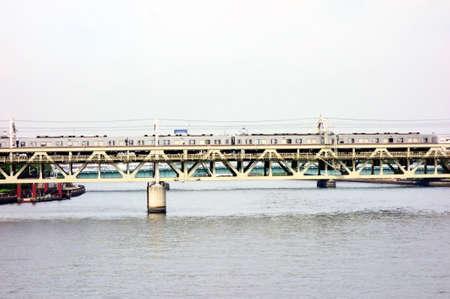 Railway dredging over a large river Редакционное
