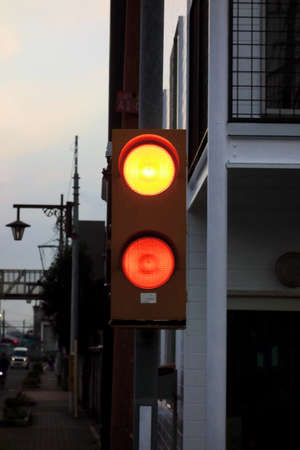 Tokyo-October 12, 2016: Light orange traffic lights on the railroad that light up at Mitaka train yard in the evening of O ctober 12, 2016 JR Редакционное
