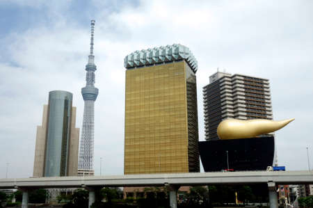 Tokyo-June 20, 2016: The symbol of the famous coffee beer maker in Asakusa, Shimomachi, June 20, 2016. You can see Tokyo Sky Tree in the distance. Редакционное