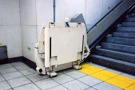 Equipment for disabled people on station stairs Фото со стока