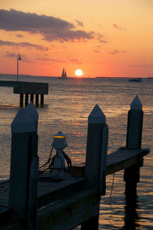 A beautiful sunset off the coast of Key West with pier Stock Photo