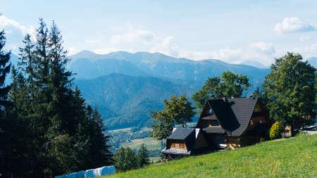 giewont: Guesthouse and mountain landscape horizon in Zakopane Stock Photo