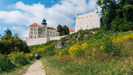 PIESKOWA SKALA, POLAND - SEP 03, 2016: Entering the ruins of the castle can be seen from a distance already Ojcowa located on a high rock on the right side of the road.