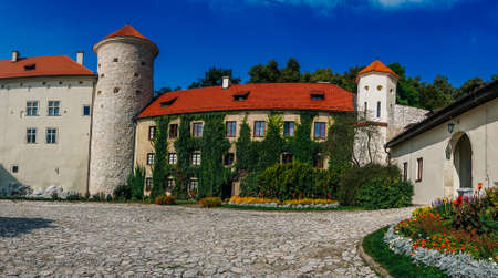 PIESKOWA SKALA, POLAND - SEP 03, 2016: Entering the ruins of the castle can be seen from a distance already Ojcowa located on a high rock on the right side of the road