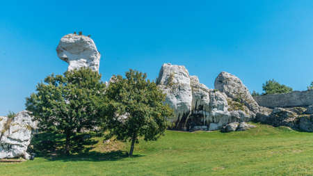 upland: OGRODZIENIEC, POLAND - SEP 03, 2016: Ogrodzieniec Castle is the largest castle of the Krakow-Czestochowa Upland and, undoubtedly, one the most beautiful castles in Poland. It is located on Mount Janowski at the heart of the Upland. Fantastic rock formatio