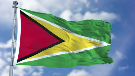 Guyana Flag in a Blue Sky. Stock Photo