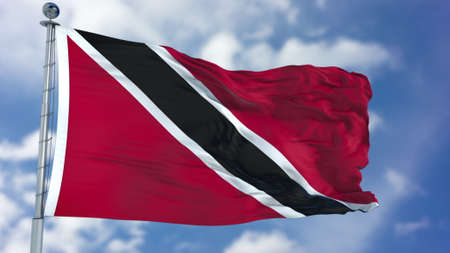 Trinidad and Tobago Flag in a Blue Sky. Stock Photo