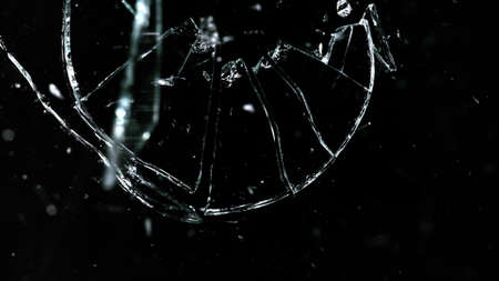 Shattered and broken glass pieces isolated on Stock Photo