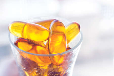 cod oil: Pure cod liver oil with simple setup on clean lighting.