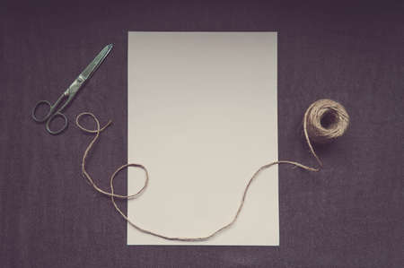 original ecological: Jute twine and old scissors on paper