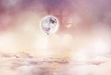photomanipulation: Imaginary World. Balloon moon above the clouds. Stock Photo
