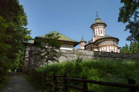back alley: Sinaia, ROMANIA - June 18 2016: Sinaia monastery seen from a back alley in a peaceful atmosphere. SINAIA - June 18 2016 Editorial