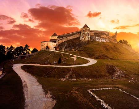 Sunset at Rasnov medieval citadel in Transylvania Stock Photo