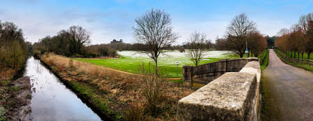 London, UK - March 17 2018: Panoramic view of Cranford Park and river Crane after a mild snowfall in March.