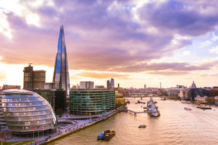 Panoramic view of London skyline at sunset. The Shard and the City Hall