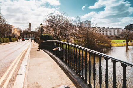 Scenery from York Bridge in Regents Park with a view towards Saint Marylebone church on a sunny day in spring.