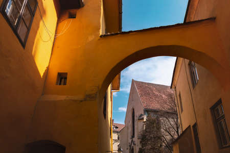 Church of the Dominican Monastery in Sighisoara, viewed through an archway