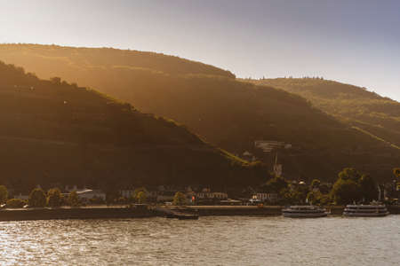 Warm sunrise light over the Rhine river and the village Assmannshausen, famed for its red wine made from Pinot Noir.