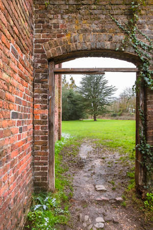 The Stable Block in Cranford Park on a cloudy day in spring