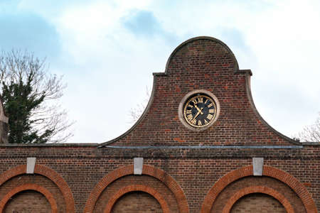 Closeup on the clock on top of the Stable Block in Cranford Park