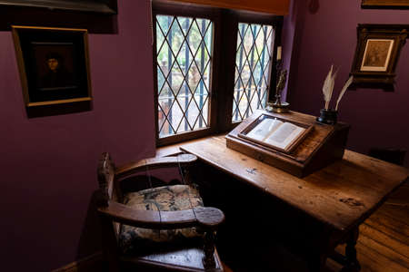 Desk with old book in Latin about at the Erasmus house in Anderlecht.