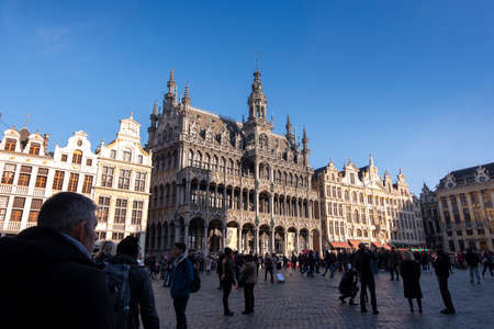 Tourists visiting the main square Grand Place on a sunny autumn day