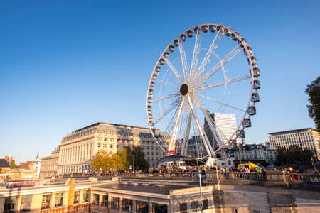 Ferris Wheel in Place Poelaert, near the Palace of Justice, in Brussels, in sunset light. Redactioneel