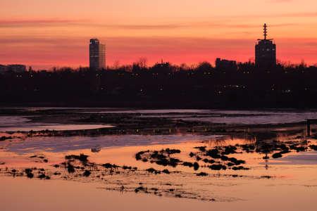 Bucharest skyline seen over the Floreasca lake in sunset light. Stock fotó