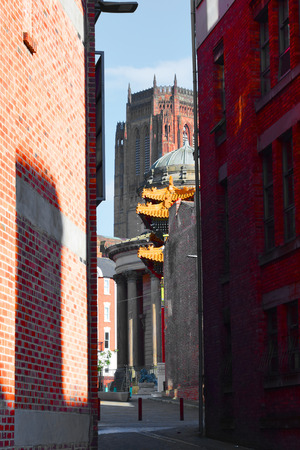 congregational: Alleyway view of liverpool cathedral, Chinatown Gate &  Great George Street Congregational Church
