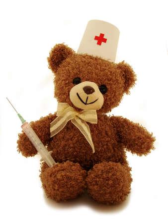 playthings:      teddy-bear medic & syringe