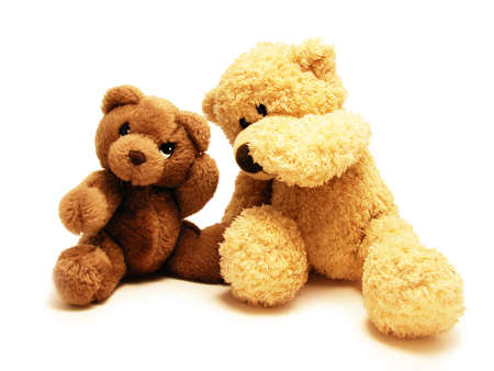 whispering:            teddy-bear whispering secrets to the other one                                                    Stock Photo