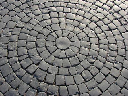 cobble: un impertinente di una strada di ciottoli come un cerchio                                Archivio Fotografico