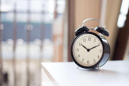 Alarm clock on the nightstad photo