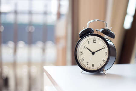 Alarm clock on the nightstad Stock Photo