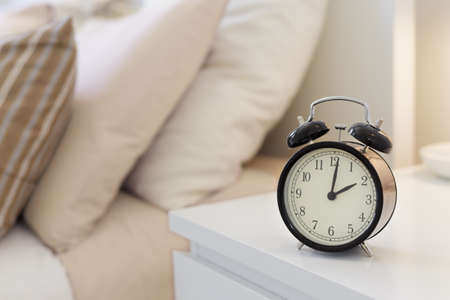 bed time: Alarm clock on the nightstad Stock Photo