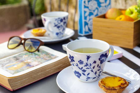 Relaxing afternoon tea outside Stock Photo