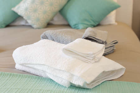 Bed with fresh towels